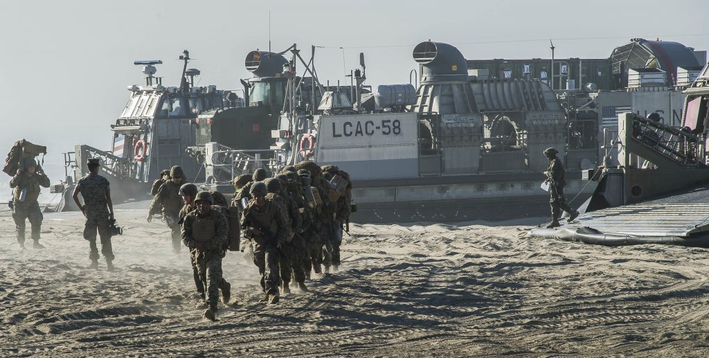 CAMP PENDLETON, Calif.  (Oct. 27, 2017) U.S. Marines disembark a landing craft air cushion (LCAC) to begin the Red Beach tactical maneuvering portion of the bilateral exercise Dawn Blitz 2017. Dawn Blitz 2017 is a scenario-driven amphibious exercise designed to train and integrate Navy and Marine Corps units by providing a robust training environment where forces plan and execute an amphibious assault, engage in live-fire events, and establish expeditionary advanced bases in a land and maritime threat environment to improve naval amphibious core competencies. (U.S. Navy photo by Mass Communication Specialist Seaman Apprentice Jailene Casso)