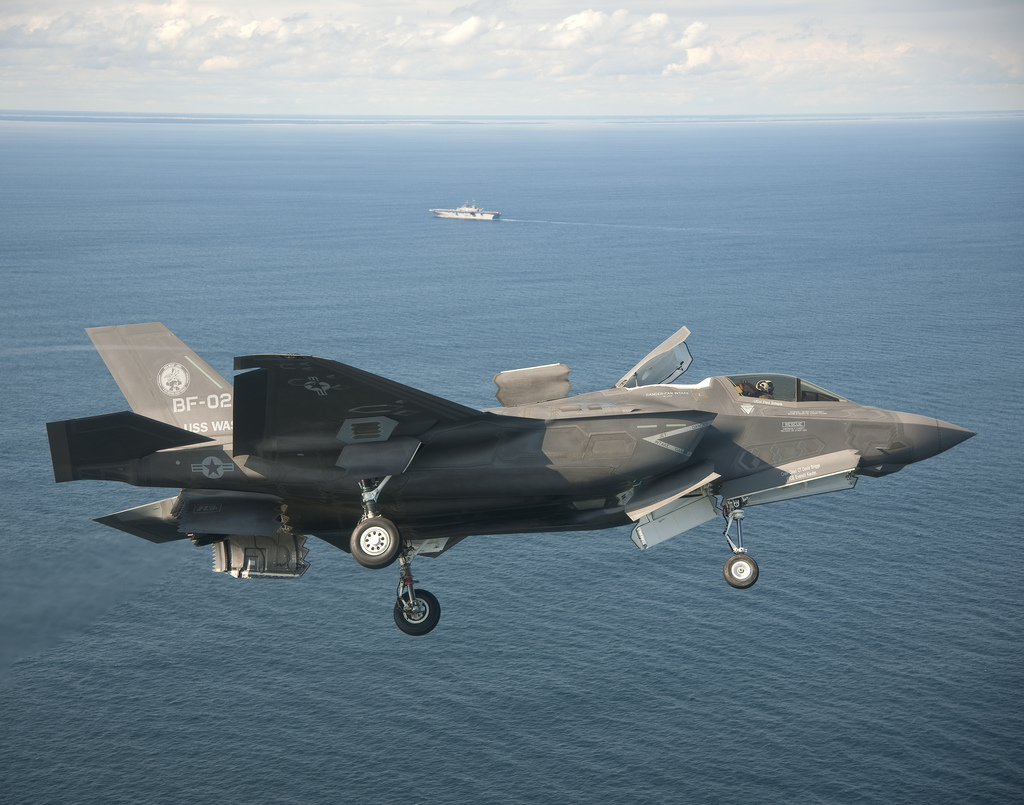 111003-O-ZZ999-001 ATLANTIC OCEAN (Oct. 3, 2011) An F-35B Lightning II conducts initial sea trials over the Atlantic Ocean. The F-35B is the Marine Corps Joint Strike Force variant of the Joint Strike Fighter and is designed for short takeoff and vertical landing on Navy amphibious ships. The aircraft is operating with the amphibious assault ship USS Wasp (LHD 1). (U.S. Navy photo by Andy Wolfe courtesy of Lockheed Martin/Released)